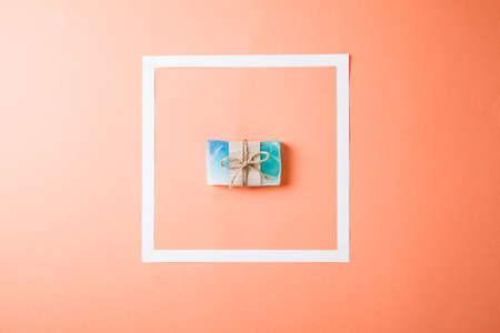 Hand made soap bars on coral background, top view. Mockup for design