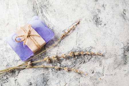 fragrant handmade soap lies on a circular base on a wooden background