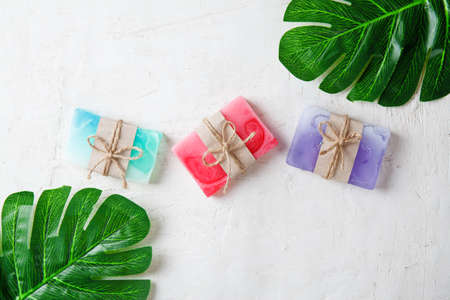 Spa composition with tropical leaves on a white background .Different organic soap, care and beauty concept, top view Reklamní fotografie - 130135629