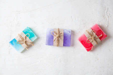 fragrant handmade soap lies on a circular base on a wooden background Фото со стока - 130135657