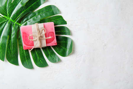 Spa composition with tropical leaves on a white background .Different organic soap, care and beauty concept, top view Reklamní fotografie - 130135806