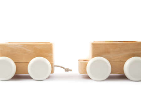 wood railway carriage on the white background. Toys