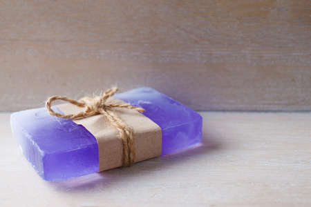 fragrant handmade soap lies on a circular base on a wooden background Фото со стока - 130135813