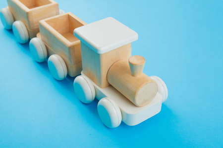 Wooden train on blue background. Toys Stock fotó - 130135814