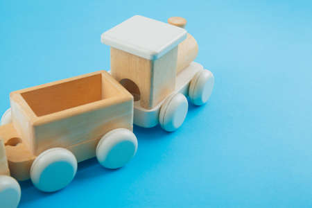 Wooden train on blue background. Toys