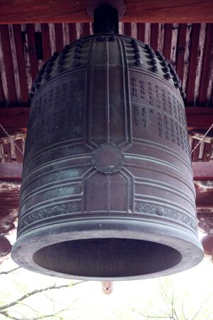 the boom of a temple bell