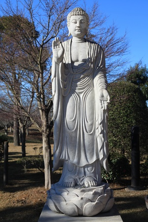 a statue of Buddha in Ushiku Stock Photo