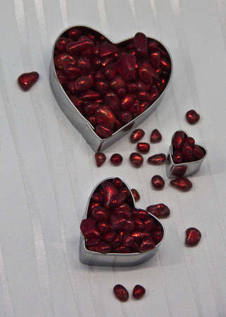 Three hearts filled with red decorative stones  photo