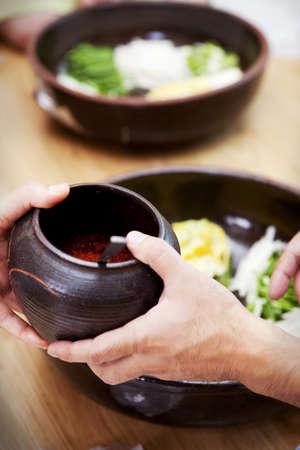 falsely: Kimchi tradition (Korean Pickled cabbage) LANG_EVOIMAGES