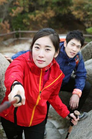 Couple climbing mountains Stock Photo - 10230712