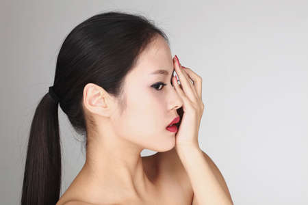 westerner: Asian girl with facial expression LANG_EVOIMAGES