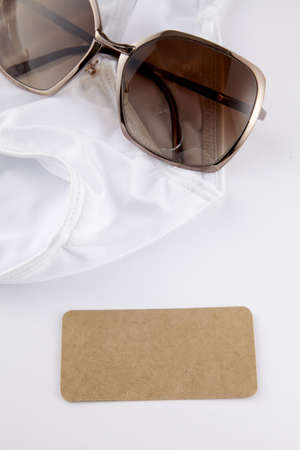 lotion bottle and sunglasses over white stones Stock Photo - 16705332