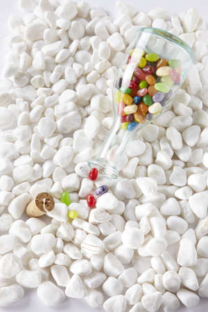 lotion bottle and sunglasses over white stones Stock Photo - 16705319