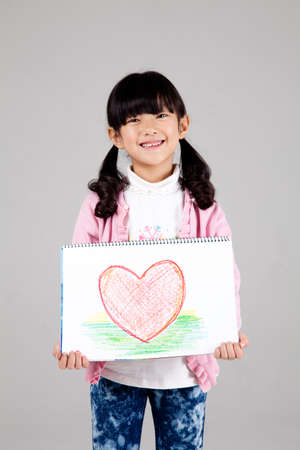 child holding artwork Stock Photo - 16744960