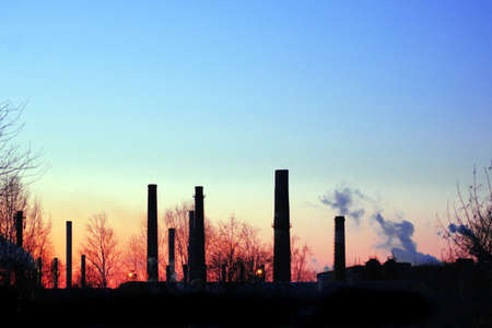 no smoke from chimneys of suspended factory in sunrise