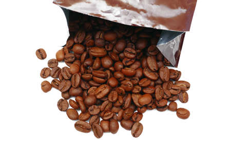 top view on roasted coffee beans spilled from plastic bag isolated on white background