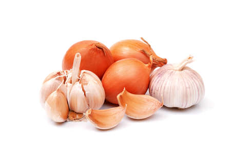 garlic and onion bulbs and cloves isolated on white background, full depth of field