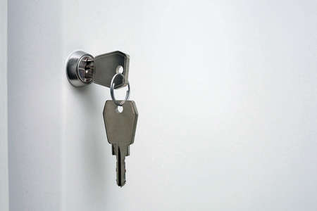 key in office cabinet lock with copy space Archivio Fotografico