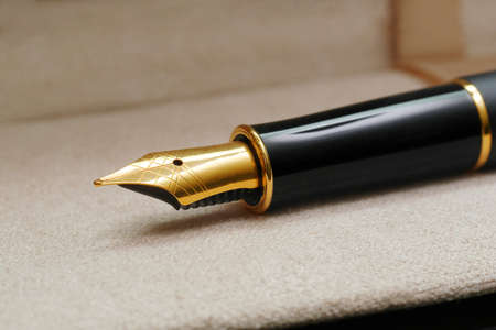 macro of black luxury gold plated fountain pen in open case