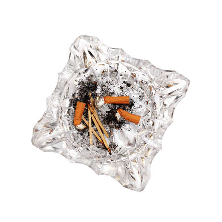 top view of cigarette butts in a glass ashtray isolated on a white background