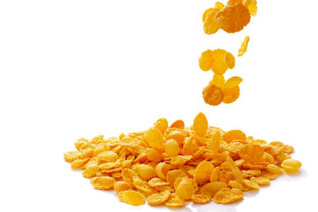 closeup of falling corn flakes isolated on white background Foto de archivo