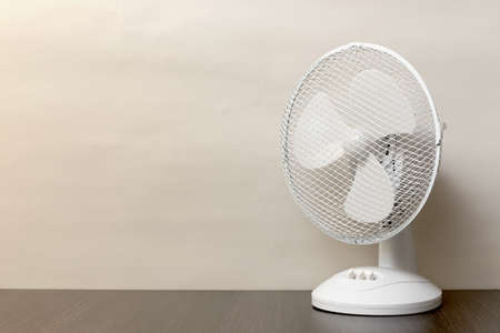 white desk oscillating fan, toned, copy space Imagens
