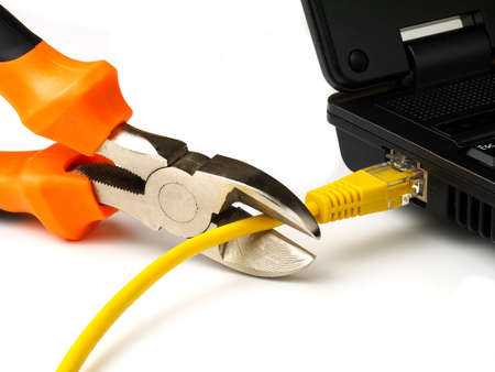 wire cutter cutting network cable from laptop on white background