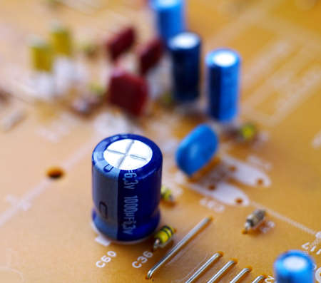electrolytic capacitor on printed circuit board, macro, selective focus