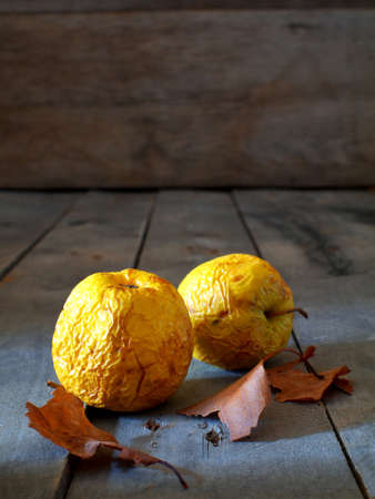 two withered apples on a wooden board with copy space Stock fotó - 152492695