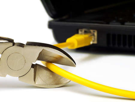wire cutter cutting network cable from laptop on white background, macro