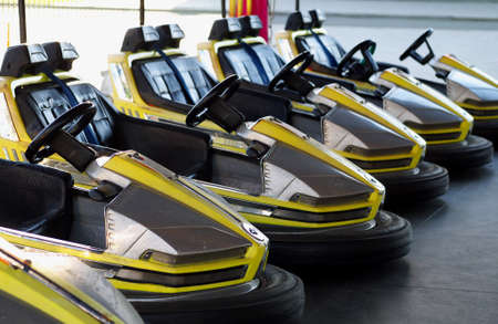 eelctric bumper cars in a row in amusement park