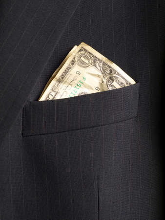 crumpled shabby one dollar banknote in a chest pocket of business suit, closeup