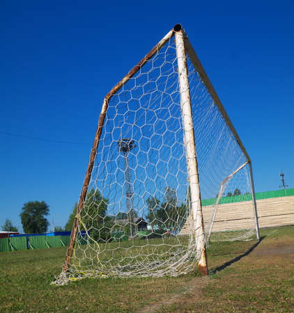 Old soccer goal on a rural football pitch Stock fotó