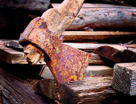 Old rusty axe with rotten haft on wooden boards, closeup, shallow depth of field, toned, lomography Stock fotó