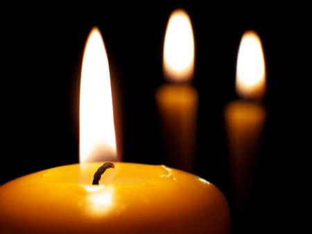 yellow burning candles on dark background, macro Stock fotó