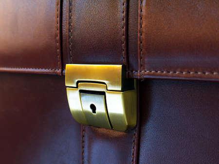 luxury brown leather briefcase lock closeup