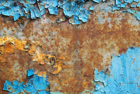 Iron sheet surface with rust stains and old painting on it with copy space