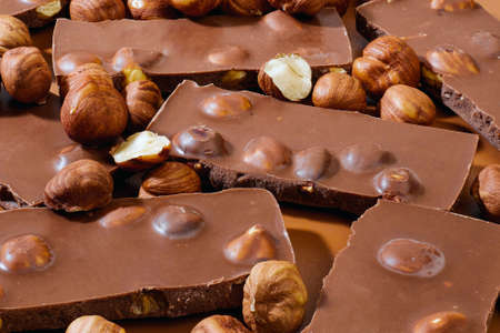 pieces of milk chocolate and hazel nuts Stock fotó