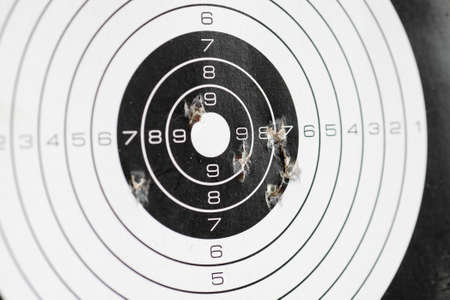 closeup of papaer shooting target with bullet holes Stock fotó