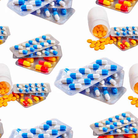 seamless pattern with pills spilled from bottle and various capsules in blister packs isolated on white background