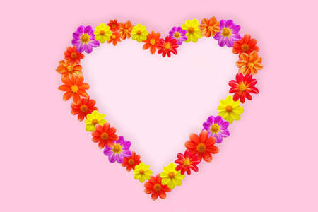 Heart shape made of various flower heads on pink background. Valentine's day. Copy space. Stock fotó