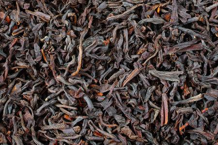 macro of black loose long leaf tea, top view, loose tea  texture