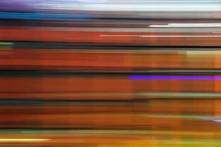 lit image: Abstract colorful image, shutter drag of night lit business building