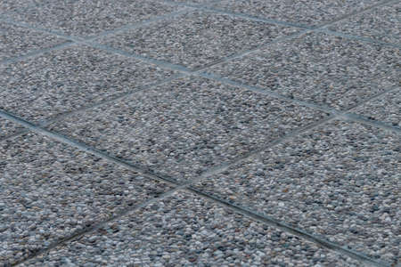 detailed shot: Detailed shot of pebbled tiles, outdoors terrace flooring Stock Photo