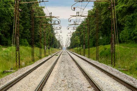 railroad tracks: Two parallel railroad tracks converging on the horizon Stock Photo