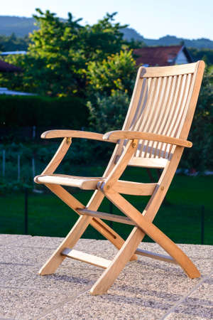 Foldable Deck Chair On Outdoor Terrace, Made Of Teak Tropical Hardwood  Stock Photo   68600192