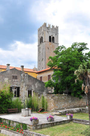 Medieval istrian town of Motovun, Croatia, shot from the castles garden, showing the tower, a well and ancient houses.
