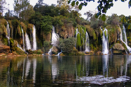 Kravice waterfalls in Bosnia and Herzegovina. A natural marble near Mostar, Bosnia and Herzegovina, at 25m (80ft) height the Trebizat river plunges down the rocks into crystal clear pools.