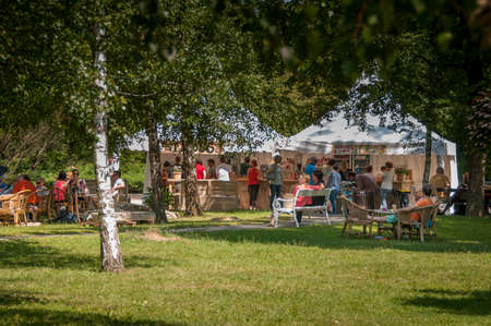 drava: Maribor, Slovenia - June 28 2014: Traditional Art camp in city park Mestni park as part of traditional Lent festival attracts young and old for cultural and leisure activities.