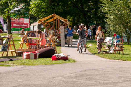 Maribor, Slovenia - June 28 2014: Traditional Art camp in city park Mestni park as part of traditional Lent festival attracts young and old for cultural and leisure activities.